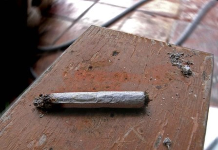 A hand rolled cigarette on a table
