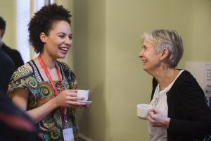 Delegates at Homeless Health 18 conference smile and laugh